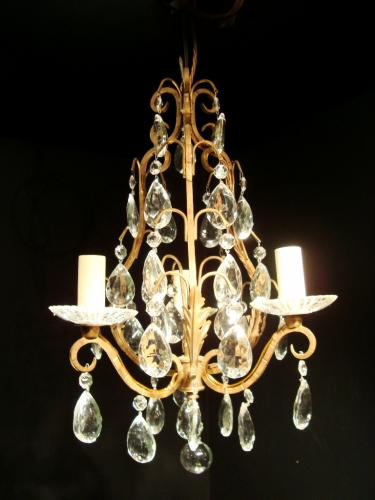 A small three arm chandelier