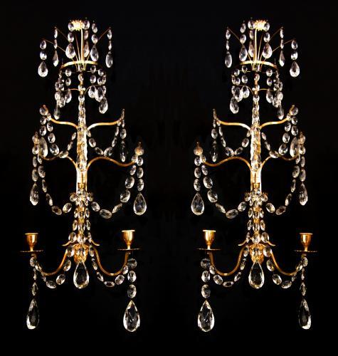 A pair of Baltic gilt brass wall lights