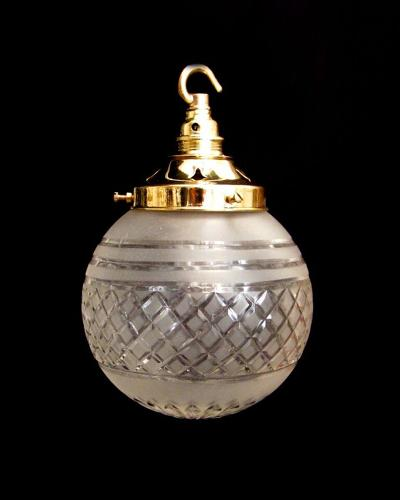 A frosted cut glass globe light
