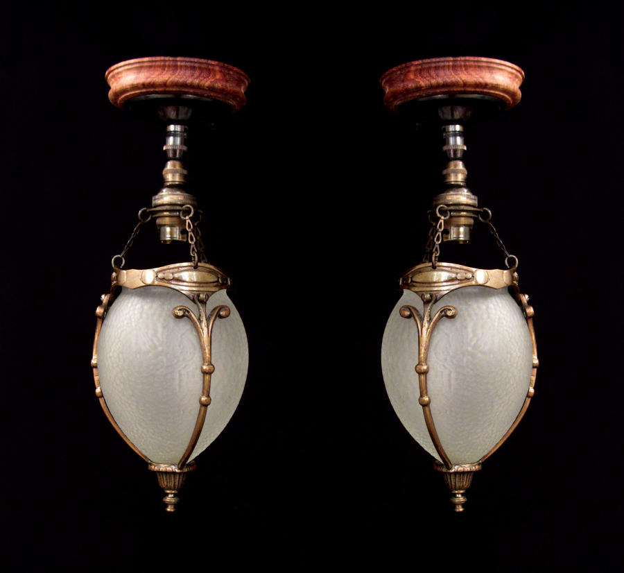 A pair of cut glass acorn lanterns
