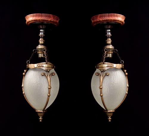 A pair of cut glass acorn lanterns