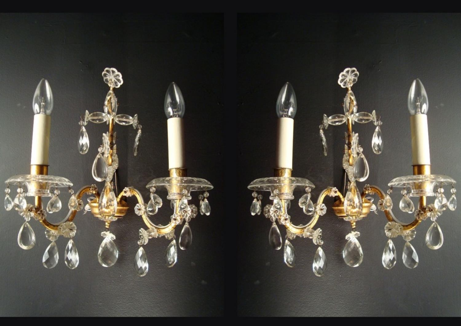 A pair of two-armed gilt iron wall lights