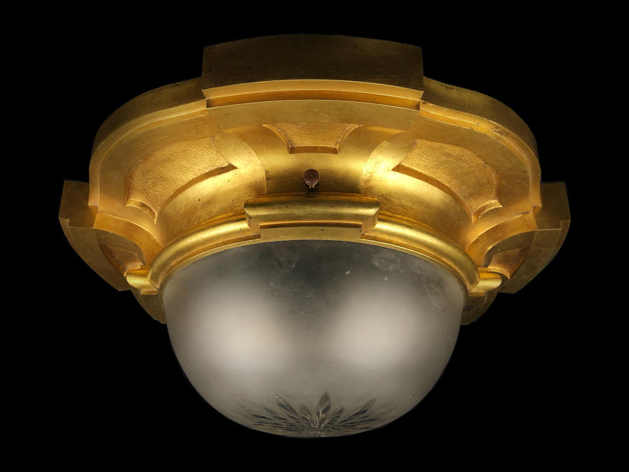 A gilt brass and frosted glass ceiling light