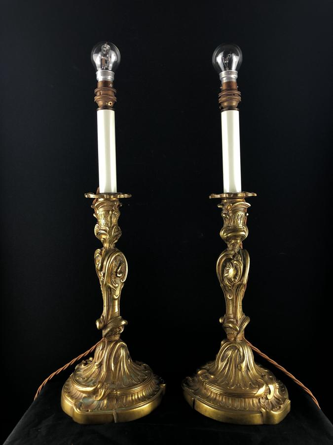 A pair of Louis XV style candlestick lamps