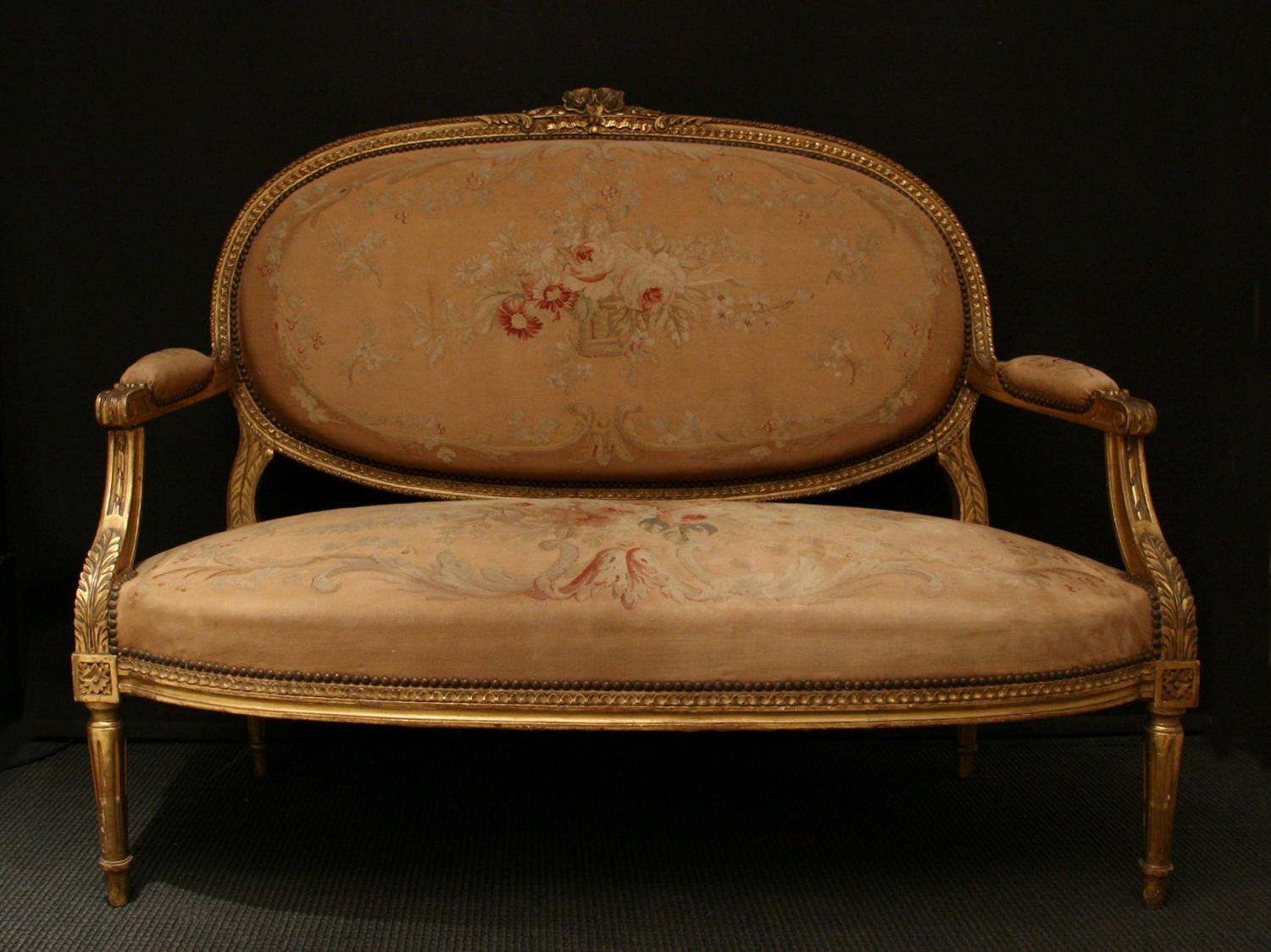A gilt-wood Louis XVI style settee