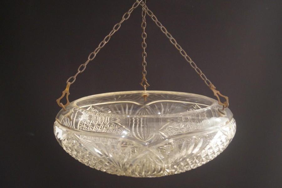 A cut glass bowl ceiling light