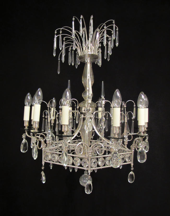 A 12 light silvered pentagonal chandelier