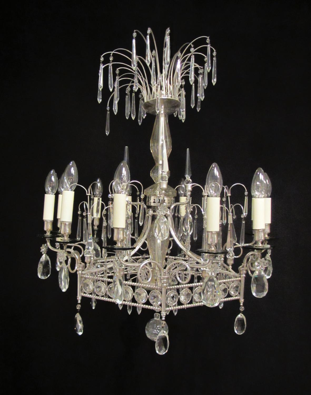A 12 light silvered pentagonal chandelier