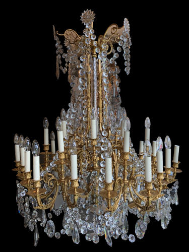 A large, eighteen light ormolu chandelier