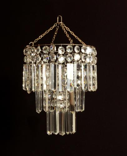 A small cut glass waterfall chandelier