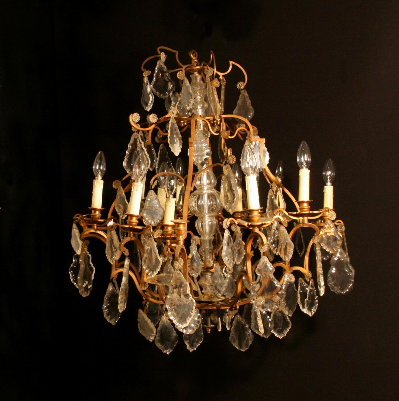 An elegant, brass and cut glass chandelier