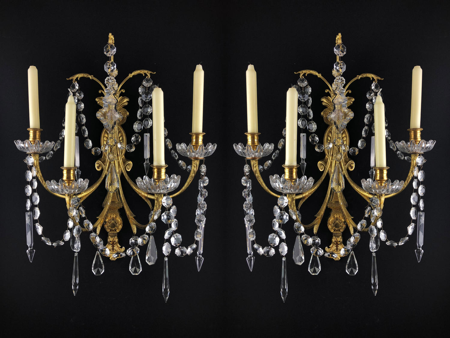 A pair of Louis XVI four arm wall lights