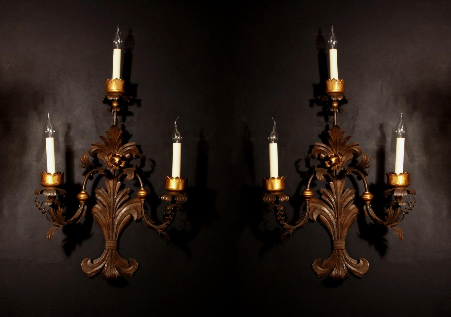 A large pair of tole wall lights