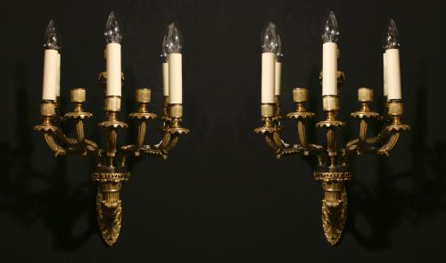 A ten arm gilt bronze wall lights