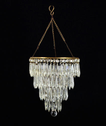 A three tier cut glass icicle drop chandelier