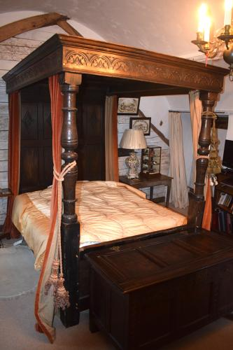 An oak tester bed