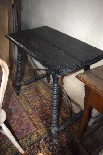 A Spanish pine ebonised base