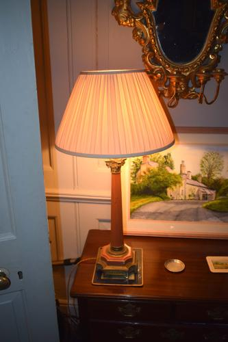 An antique rouge column lamp