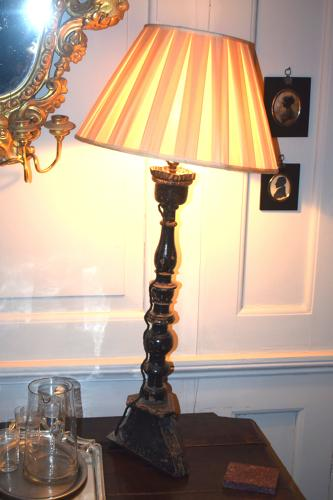 A matched pair of ebonised candle sticks