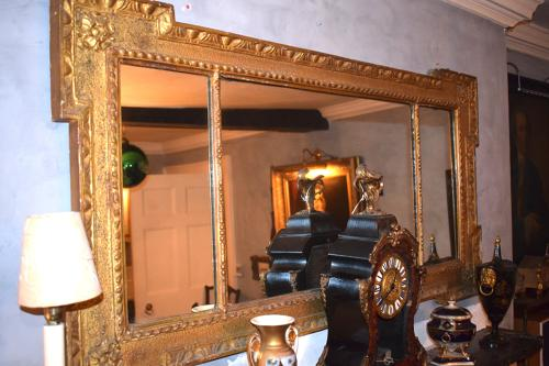 An 18th century egg and dart mantel mirror