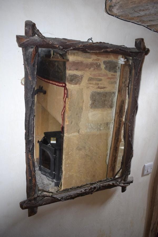 A rusticated folly mirror