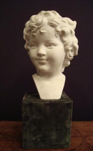 A White Porcelain Bisque Head Of A Child, Signed 'Mary ?'