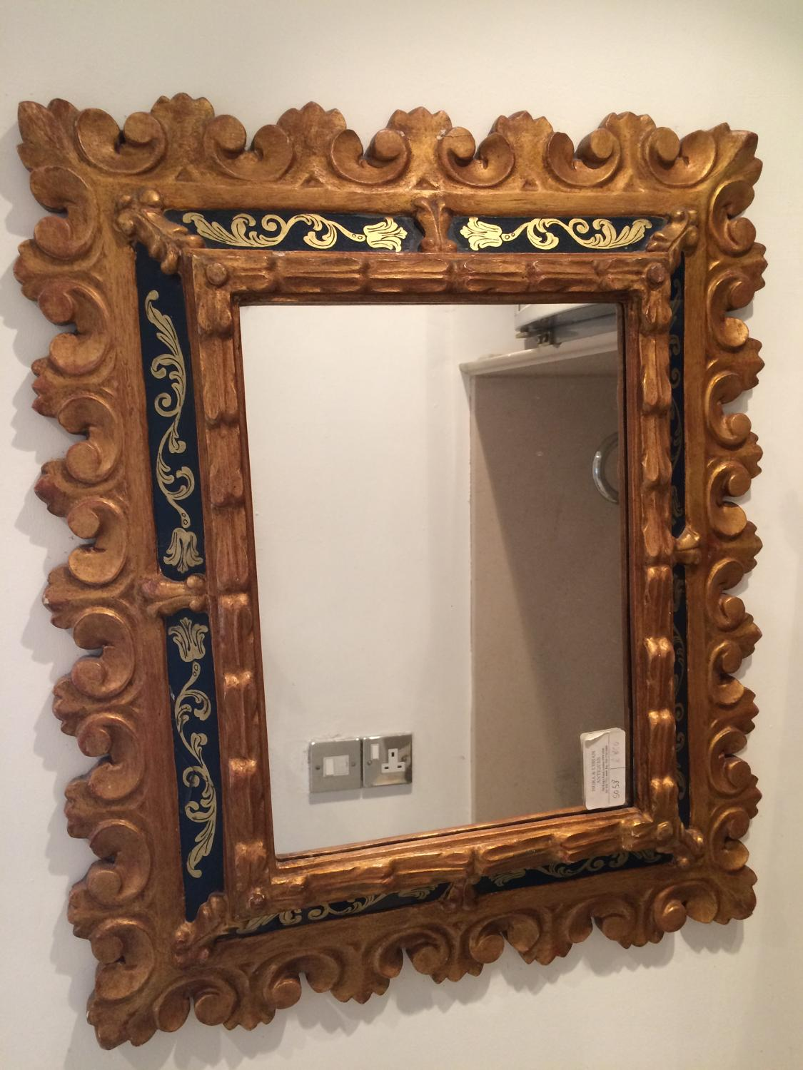 A Small Carved Wood And Gilded Mirror