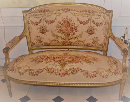 A Louis Phillipe water gilded and carved small settee