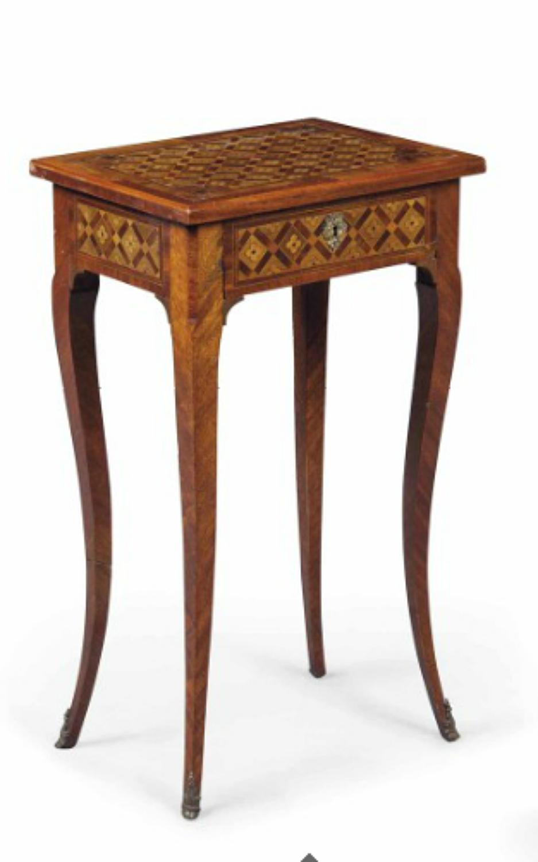 A Louis XV Mahogany and Fruitwood table
