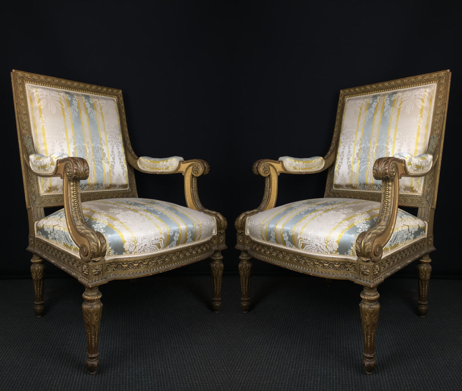 A set of Four Gilded Louis IX Style Armchairs