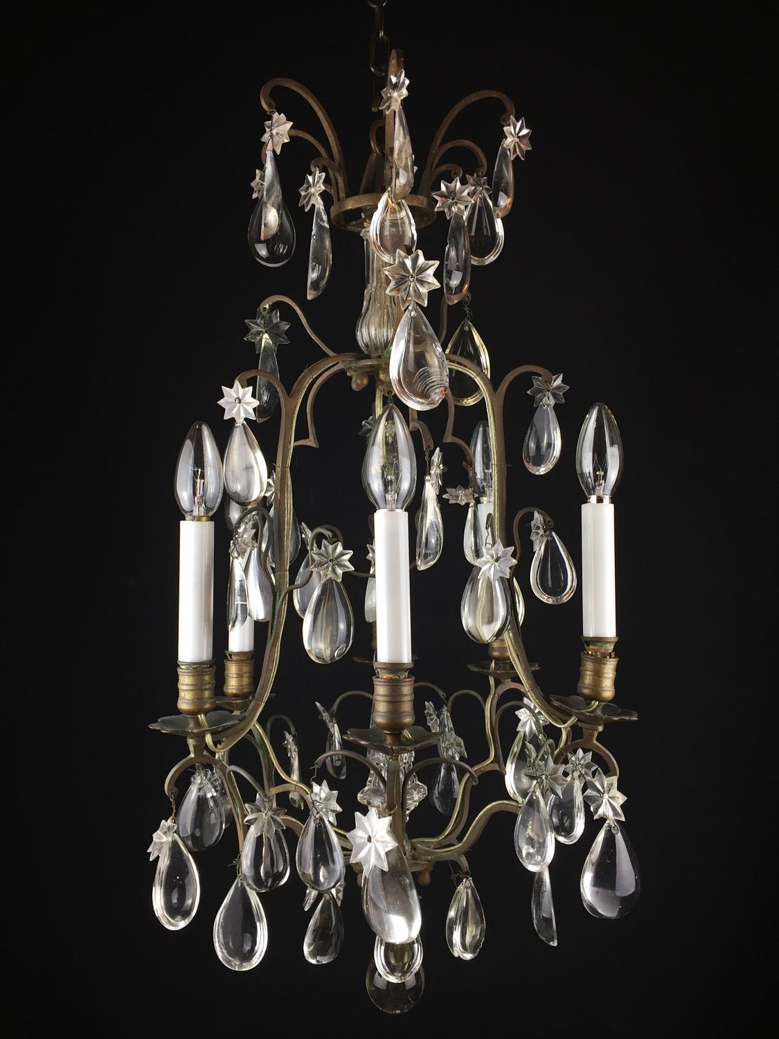 A French six arm bronze chandelier