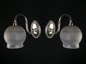 A pair of Edwardian silver plated single arm wall lights - picture 1