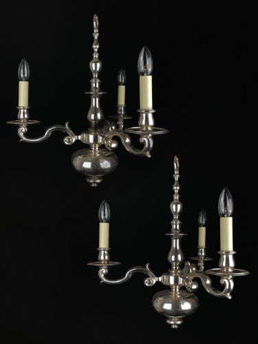 A pair of silvered chandeliers