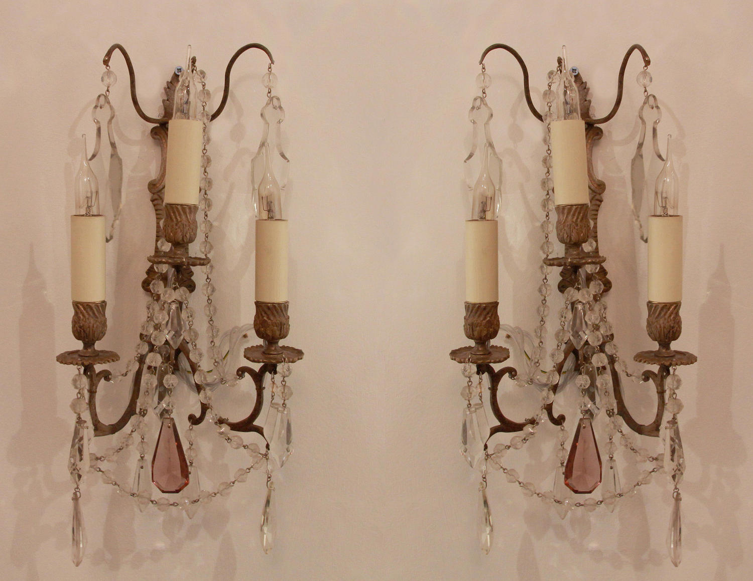A pair of French, silvered wall lights