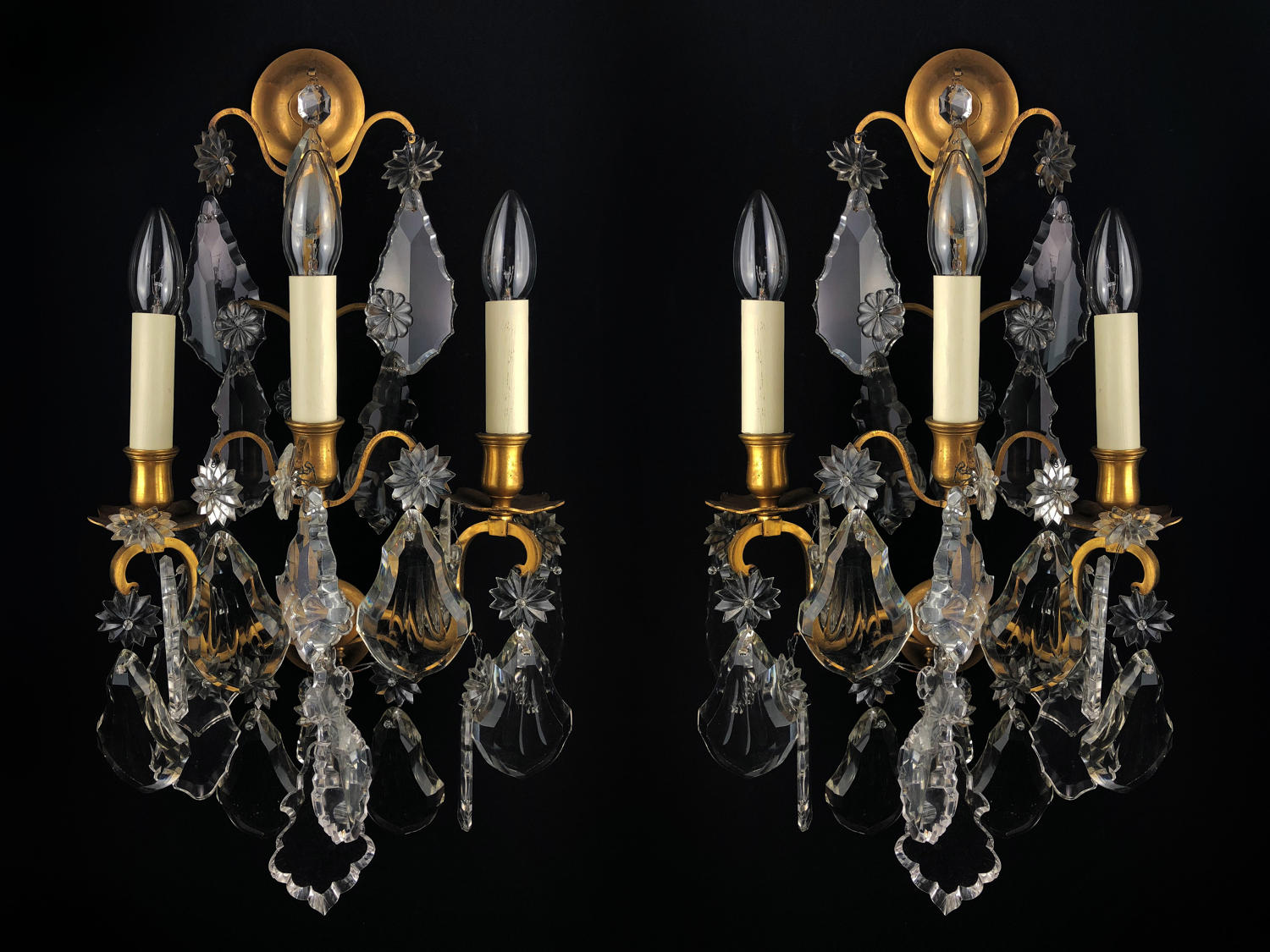 A pair of Baccarat three arm wall lights