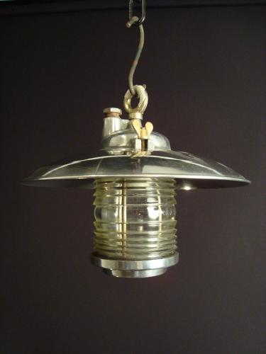 A silvered holophane ceiling light