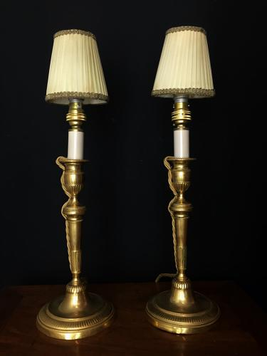 A pair of candlestick lamps