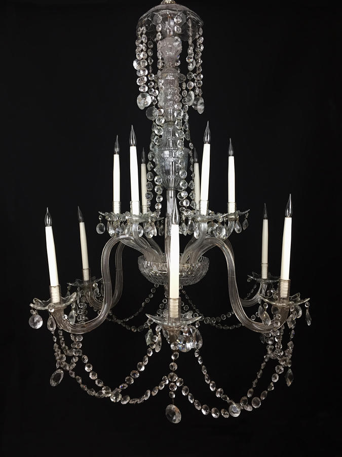 A large twelve arm cut glass chandelier