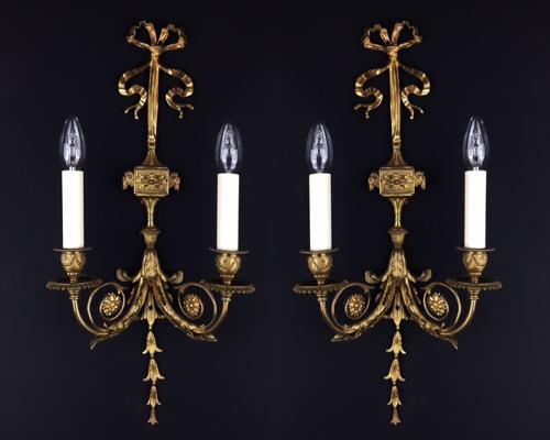 A set of 5 Louis XVI style gilt bronze wall lights