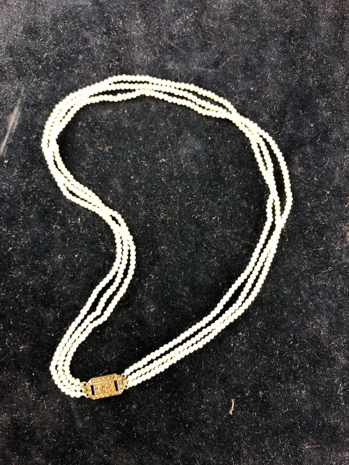 A delicate small three strand seed pearl choker