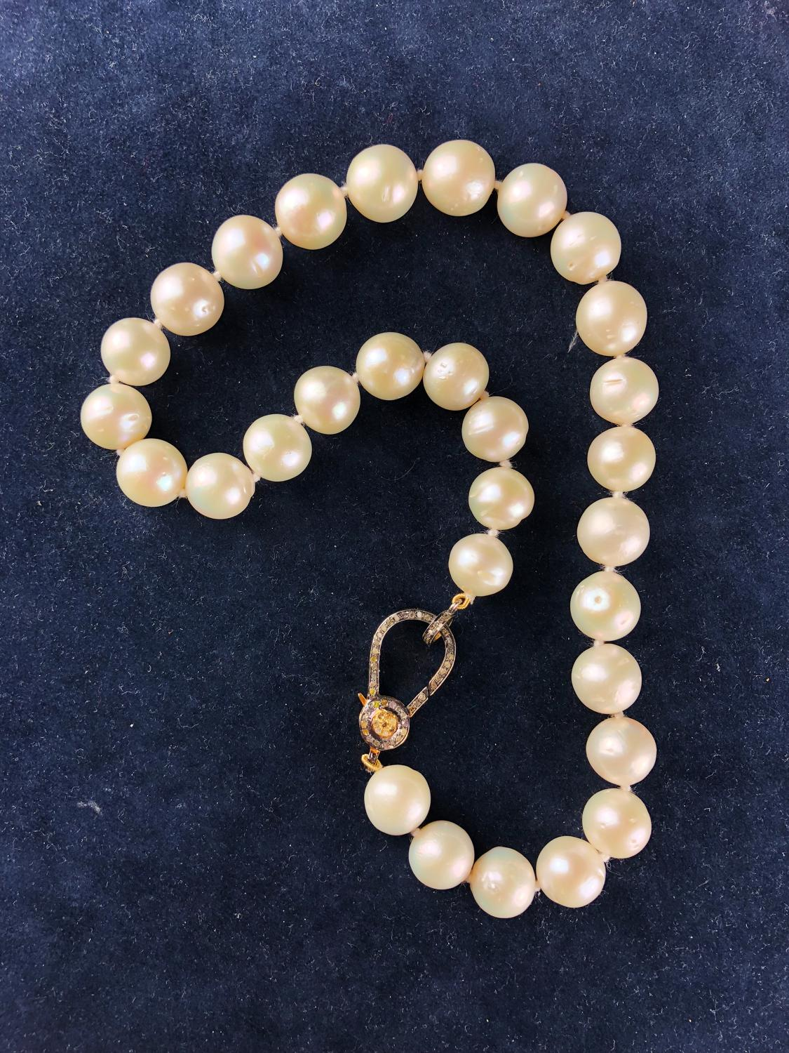 A Large Baroque 30 Pearl Necklace