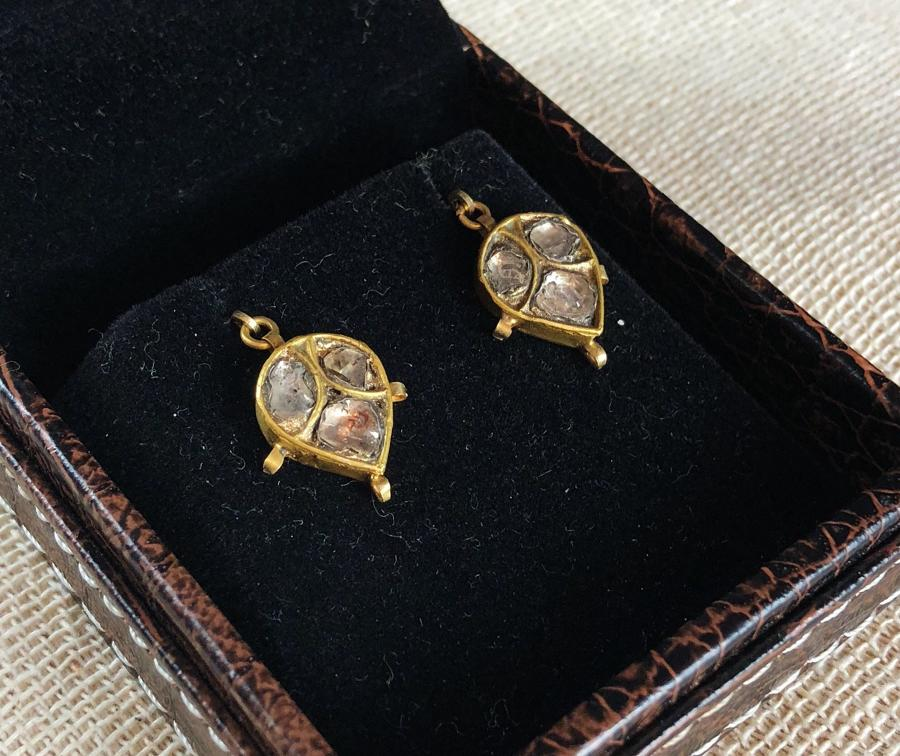 A pair of high carat yellow gold earrings