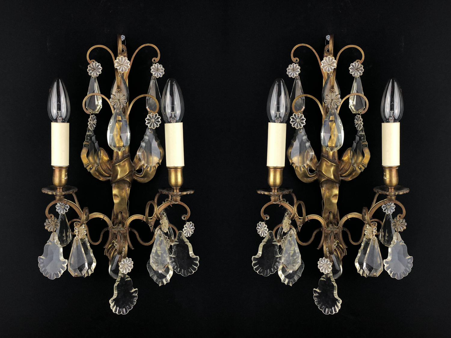 A pair of Louis XVI style wall lights