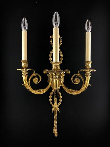 A large 3 arm Louis XVI style wall light