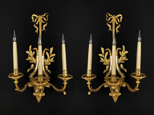 A large pair of Empire style wall lights