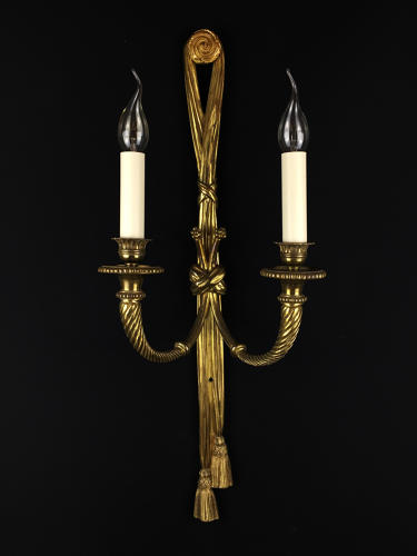 A single ribbon tassel wall light