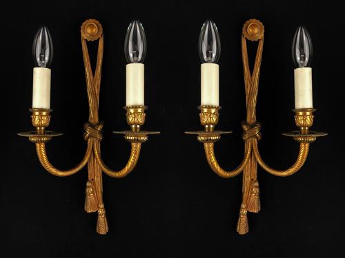 A set of three tassel wall lights