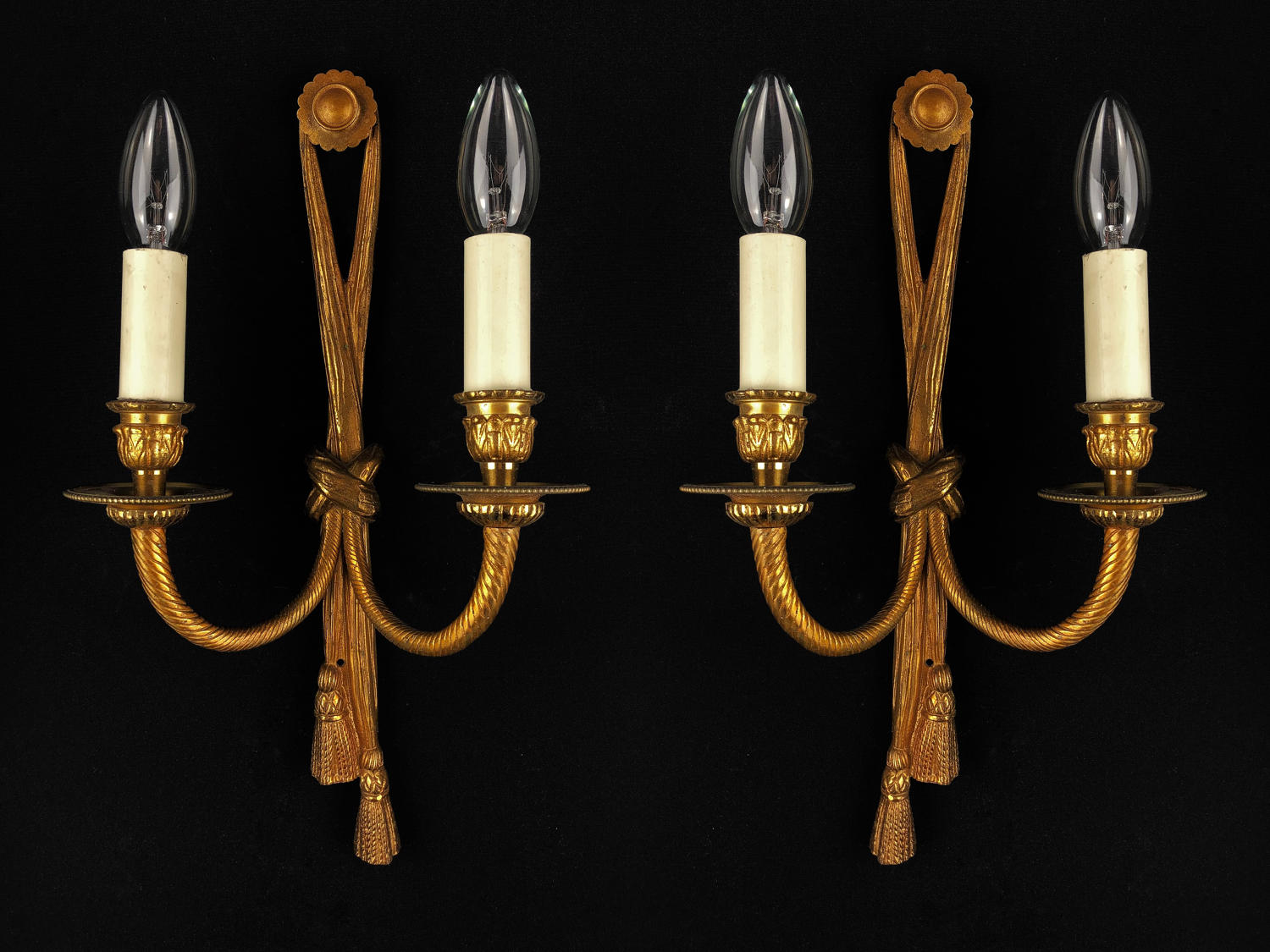 A set of three tassel wall lights