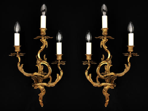 A pair of three arm Louis XV style wall lights