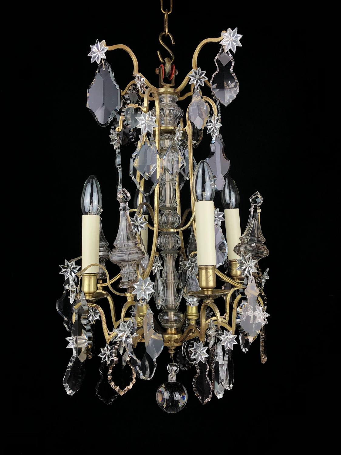 A small gilt and crystal chandelier